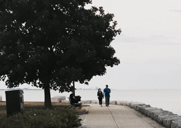 UMass Boston student Jitesh Vats took this photo of people walking on the HarborWalk.