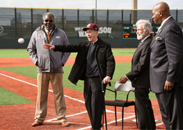 Father Monan throws the first pitch at the dedication of Monan Park.