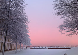 A snowy UMass Boston campus at sunset