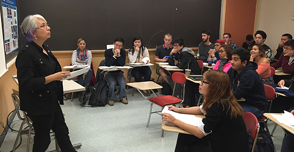 Karen Suyemoto teaches in a classroom at UMass Boston.