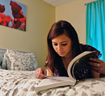 Girl reading a book in her bedroom
