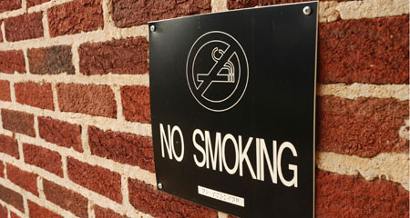 Image that says No Smoking. The UMass Boston campus is going tobacco-free on January 19, 2016.