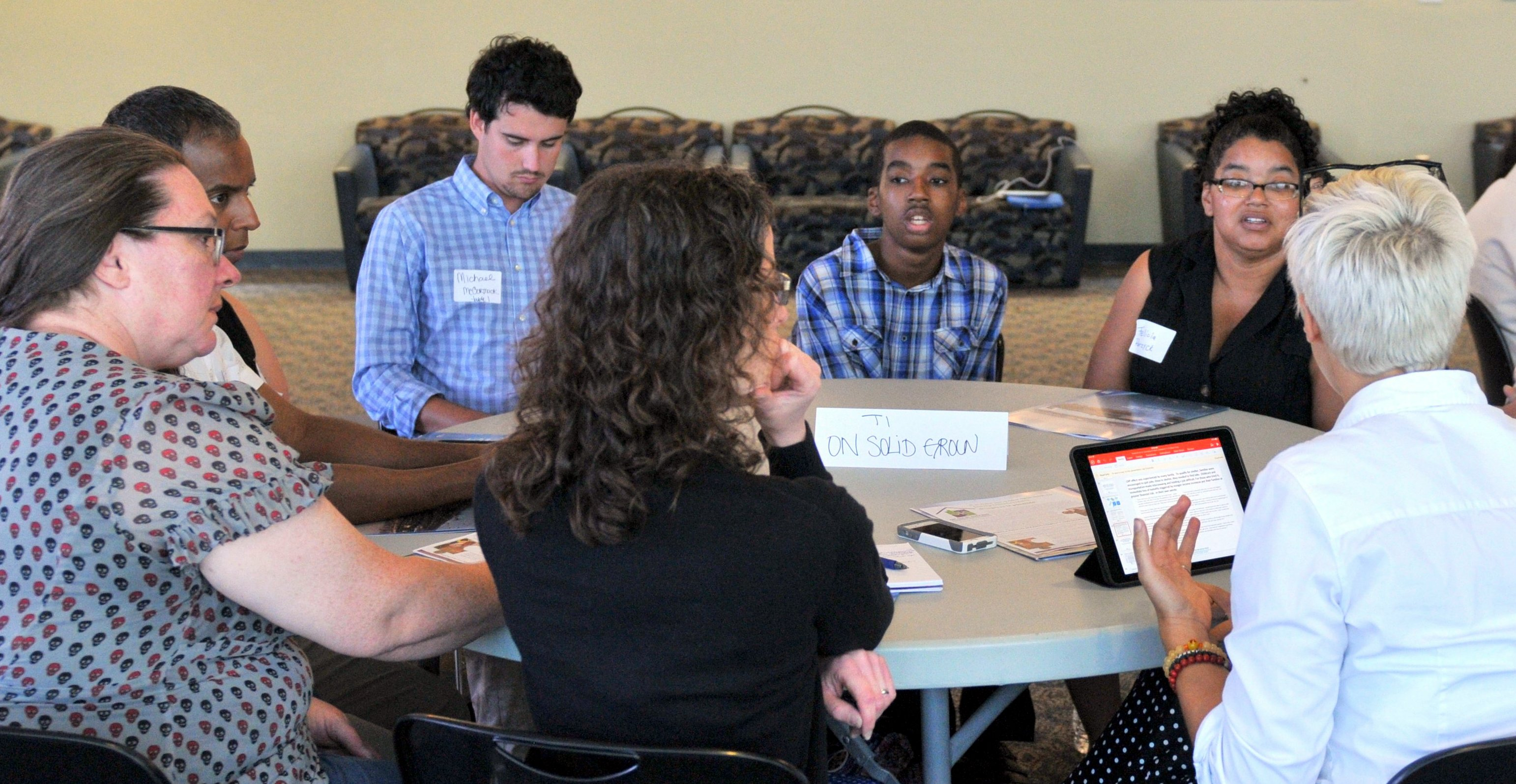 Symposium participants discuss Center for Social Policy's On Solid Ground research project.