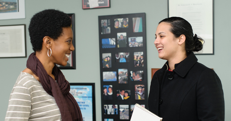 As a student here, Leslie Stevenson (left) talks politics with a classmate at UMass Boston's McCormack Graduate School.