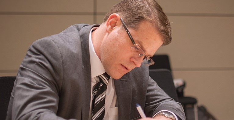 McCormack Graduate School student of global governance takes notes at Qatar conference he helped plan