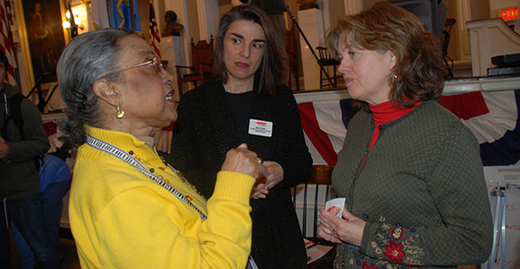 Gerontology Professor Jan Mutchler (right) speaks with Boston residents at Age-Friendly City kickoff event.