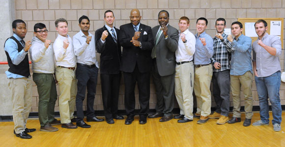 Chancellor J. Keith Motley and Vice Chancellor Charlie Titus pose with the 2013 LEC champion men's tennis team.