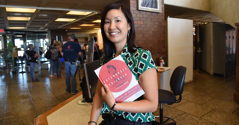 Leslie Wang with her new book