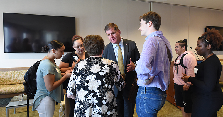 Mayor Marty Walsh meets with students after the scholarship event.