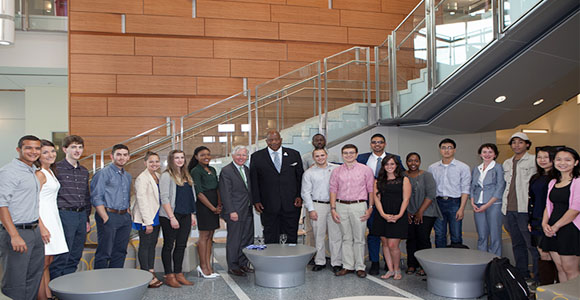 UMass President Marty Meehan and Chancellor J. Keith Motley stands with students in UMass Boston's Integrated Sciences Complex