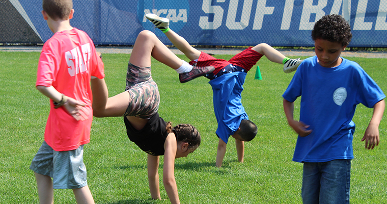 Campers play on the field at UMass Boston's Camp Shriver.