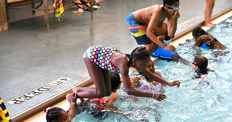 Campers swim in the pool at Camp Shriver at UMass Boston.