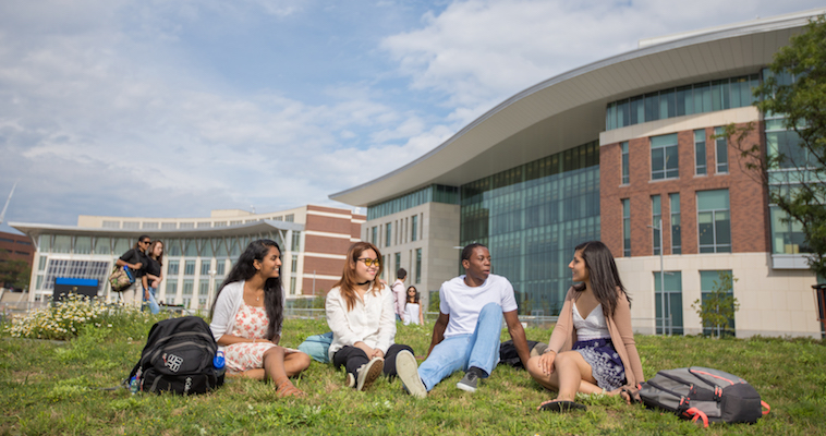 Students relaxing on the lawn in front of University Hall.