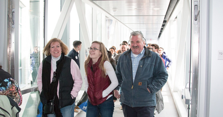 Parents and a student tour campus on Welcome Day