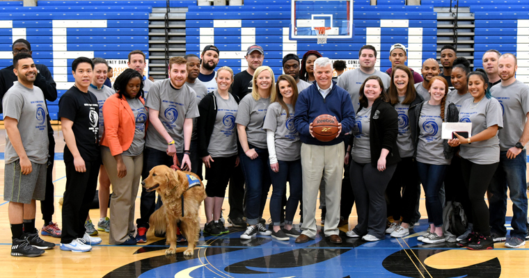 Organizers of the Basketball for Peace Tournament and Dan Conley, holding a basketball