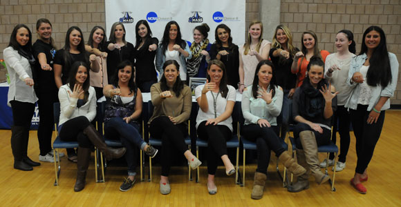 Members of the 2012 Beacons soccer team with their Little East Conference championship rings