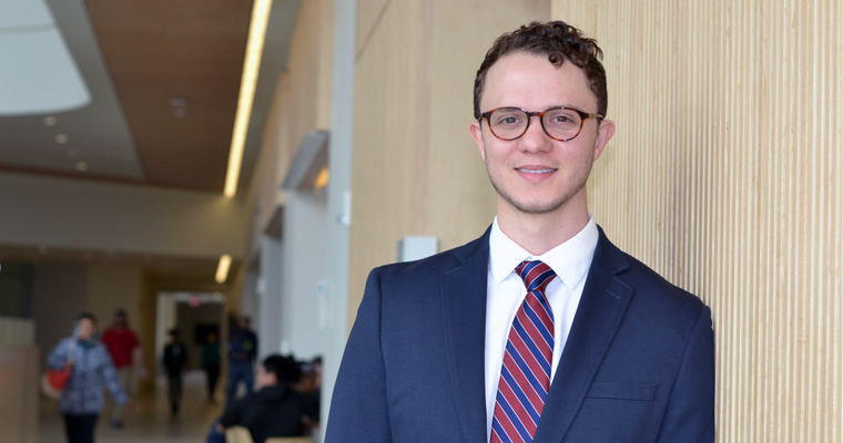 Fulbright winner Tim Brady '17 stands in University Hall