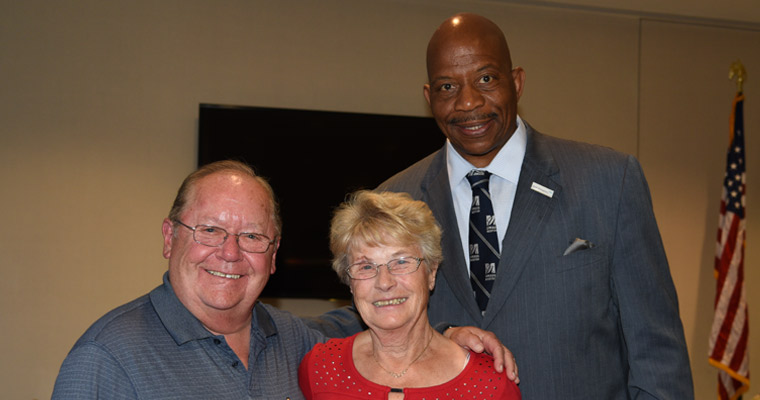 The first CPCS alumnus with his wife and Chancellor Motley.