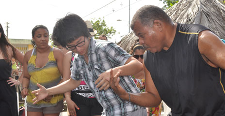 The Ayala family taught UMass Boston student Cong Zhou how to dance Bomba in San Juan.