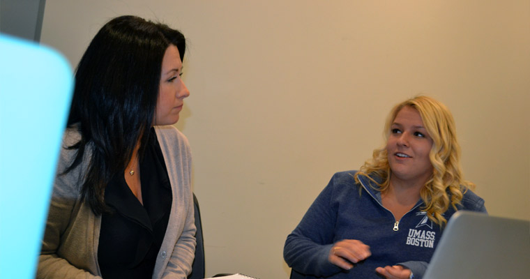 Two College of Education and Human Development students engaged in conversation