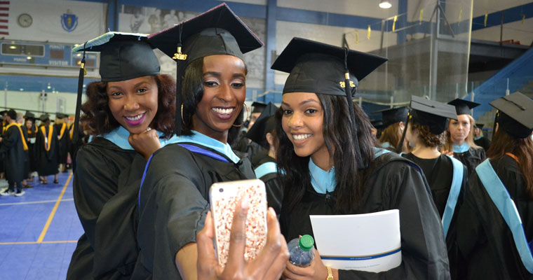 College of Education and Human Development graduates pose for a selfie.