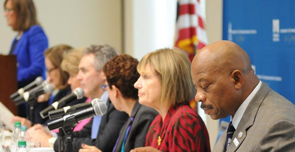 UMass Boston's Ann Bookman (third from right) took part in the panel, along with Chancellor J. Keith Motley (far right).