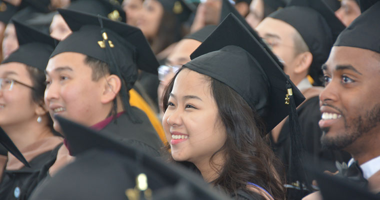 Graduate students in UMass Boston's Class of 2017 watch the commencement exercises