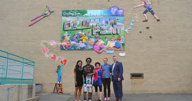 Laura DeDonato Wiatt, Queenette Santos, Joan Arches, Lindsey Connors, and Community Relations Director Phil Carver in front of the mural