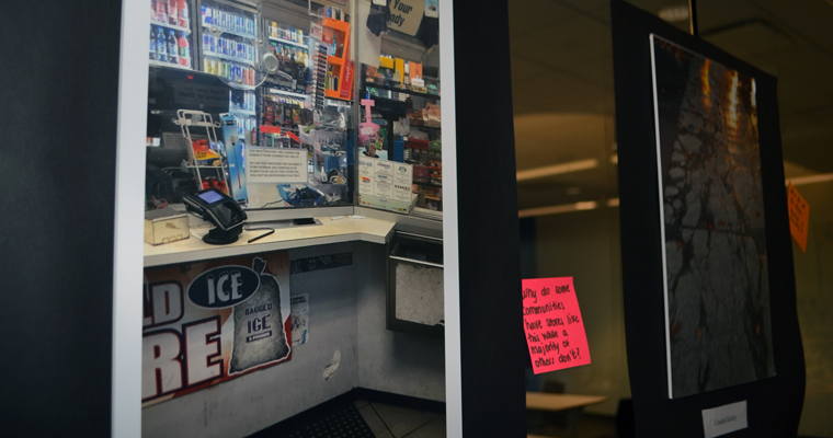 Convenience store shows plexiglass separating clerk from customers
