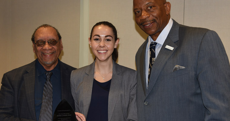 Christina Gregg, with Cuf Ferguson and Chancellor J. Keith Motley, accepted the award on the senator's behalf.