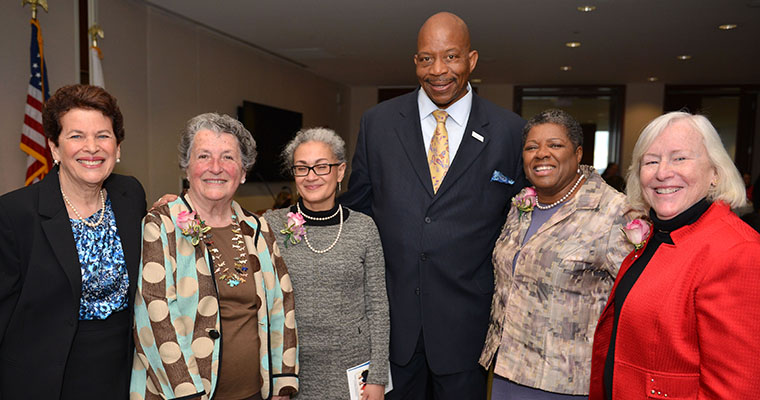 Photo of four new Distinguished Public Service Leaders Fellows with Chancellor Motley and CWPPP Director Ann Bookman.