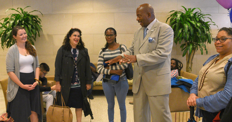 Chancellor Motley greets School for Global Inclusion and Social Development students