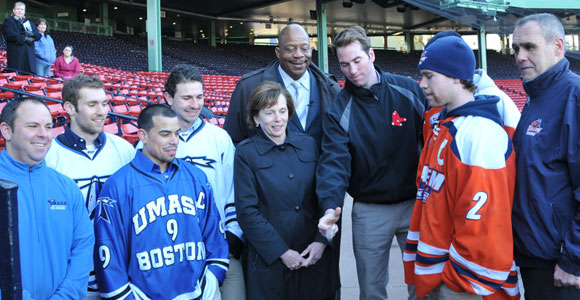 Chancellor J. Keith Motley and Salem State President Patricia Meservey (center) watch the Frozen Fenway coin toss.