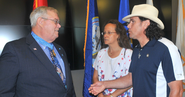 Medal of Honor recipient Charles Hagemeister (left) with Melida Arredondo '92 and Carlos Arredondo