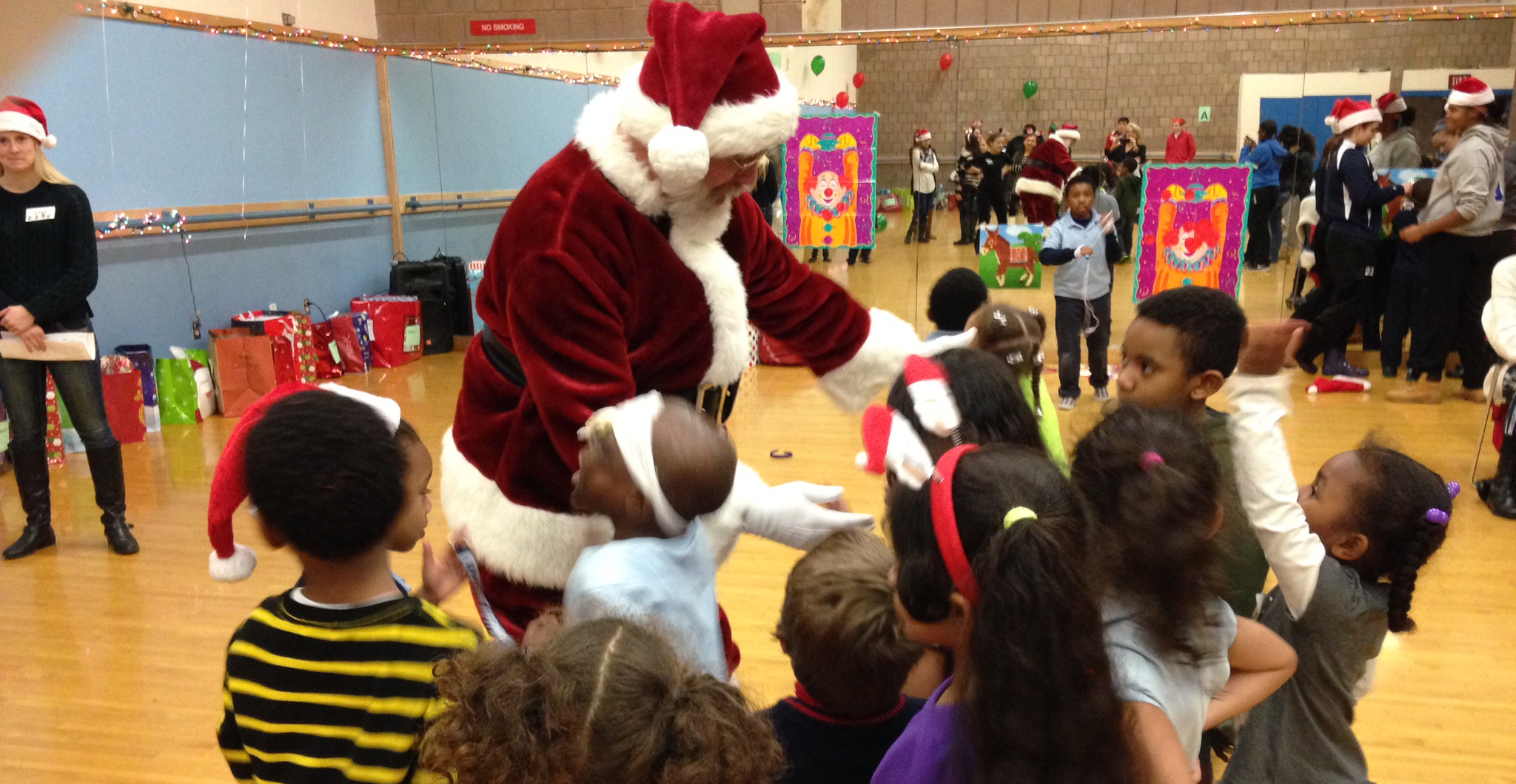 UMass Boston Athletics Participates in Helping Hands Gift Giving Celebration