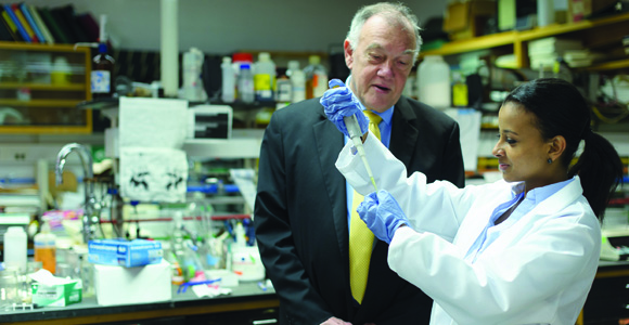 Honors College instructor Bill Hagar with a student in a lab