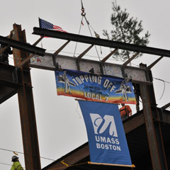 The signed ISC steel beam is lowered into place