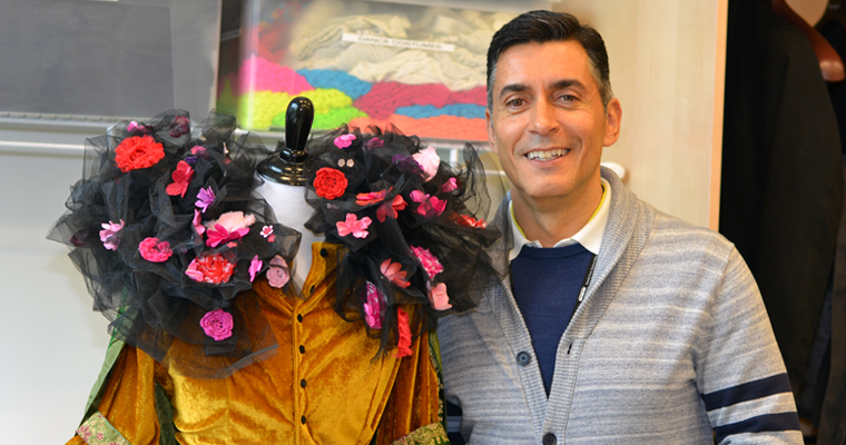 Assistant Professor of Costume Design Rafael Jaen with one of his creations in the Costume Shop in the new University Hall.
