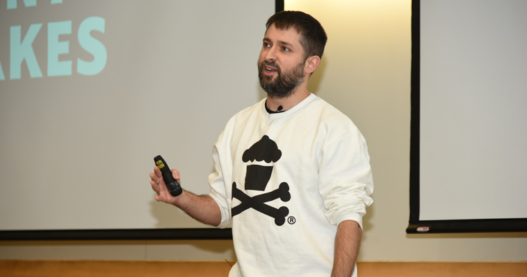 Johnny Earle, founder of the Johnny Cupcakes T-shirt brand, delivers a presentation in University Hall