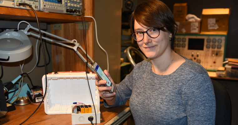 Assistant Professor of Engineering KC Kerby-Patel is shown with an EclipseMob monitoring kit.