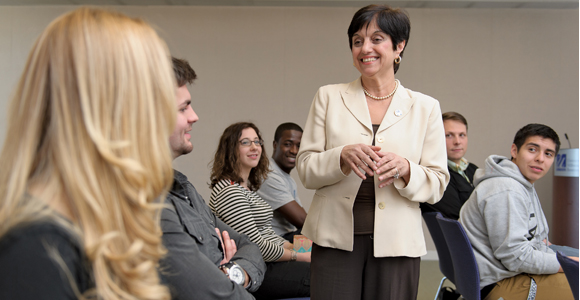 College of Nursing and Health Sciences Dean Anahid Kulwicki speaks to students.