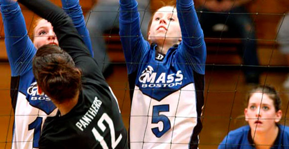 Volleyball player Kate (McWhorter) Carlson '10 (center) is one of the newest inductees into UMass Boston's Hall of Fame.