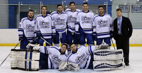 The seniors on the men's hockey team pose on the ice