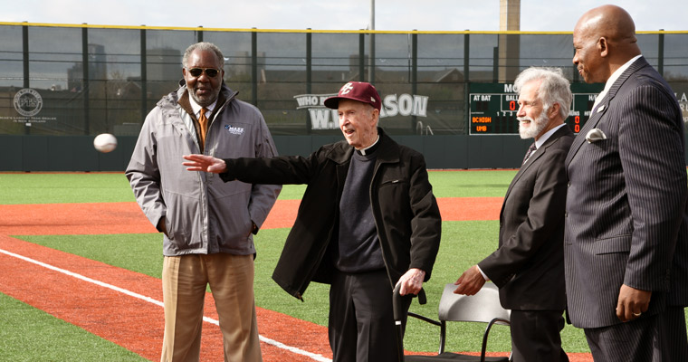 Father J. Donald Monan, SJ throws out the ceremonial first pitch at his namesake, Monan Park.