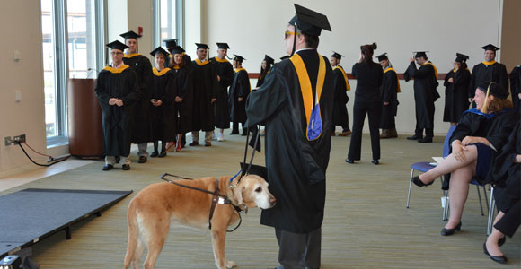 Grad Student, Guide Dog Lead McCormack Graduates at UMass Boston's Commencement