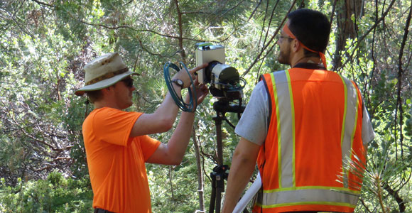 UMass Boston doctoral students Ian Paynter and Eddie Saenz set up a Canopy Biomass Lidar (CBL) in the Sierra National Forest.