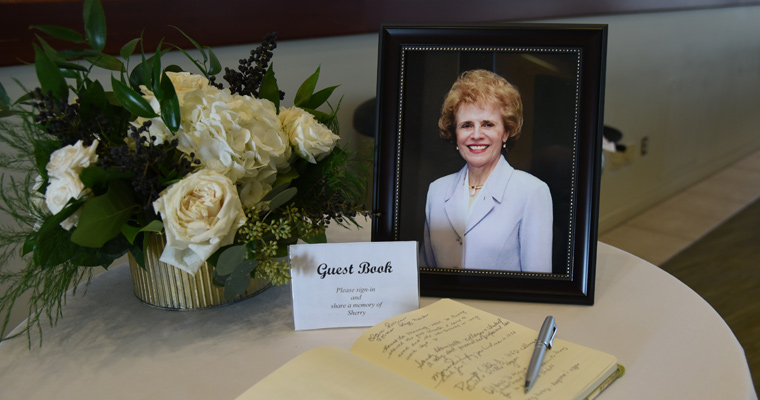 Guest book next to photo of Sherry Penney
