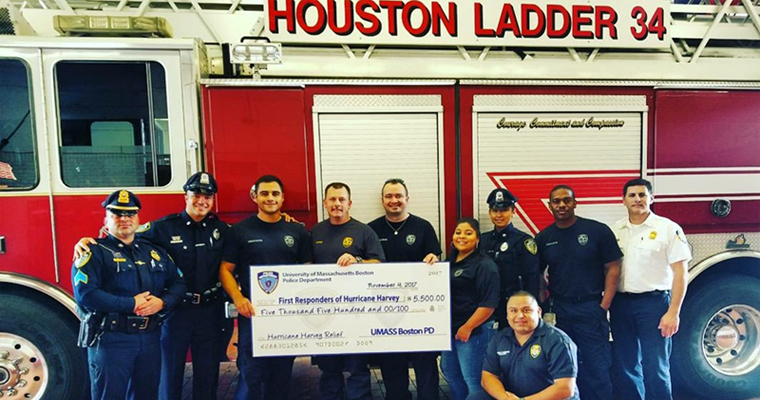 UMB Police present a check to Houston first responders.
