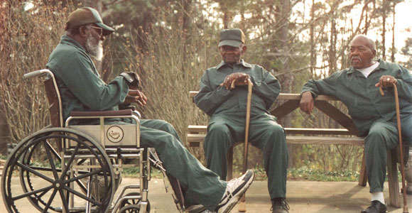 Lonnie Laney (center) chats with two other unidentified aging inmates on the grounds of the McCain Correctional Hospital in NC.