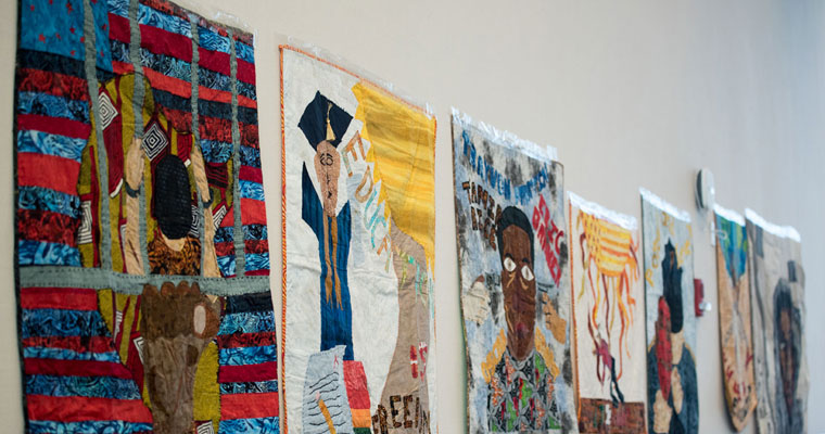 Quilts hung in the Campus Center during the arts symposium